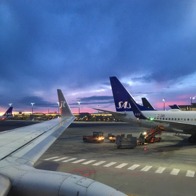 Planes parked at the airport in the evening